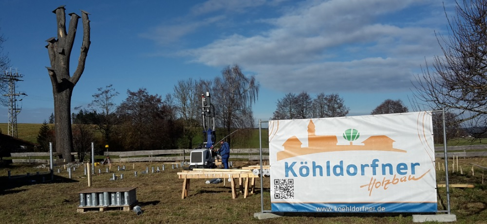 https://www.koehldorfner.de/wp-content/uploads/2018/02/20180131_köhldorfner-muster-holzhaus-schraubfundament-1000x460.jpg