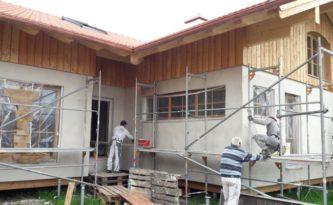 Köhldorfner Muster-Holzhaus mit Fassade aus Holz und Putz